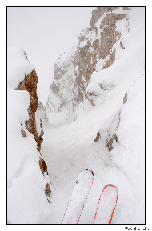 steep rock walled chute in pow in may